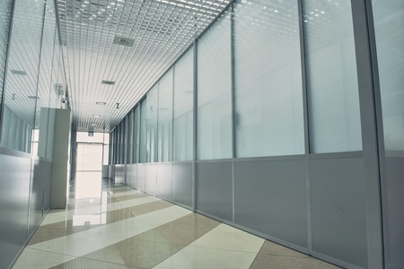 Design of long bright hallway with colourful floor and glass walls Stock Photo