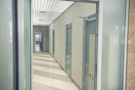 Modern hallway with contemporary glass doors locating opposite each other