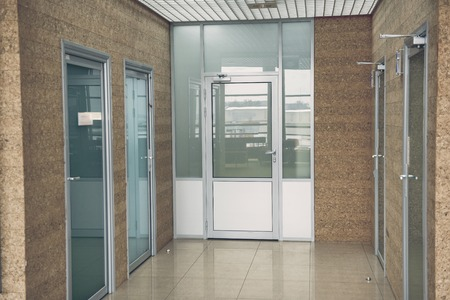 Four modern doors situating opposite each other in business center