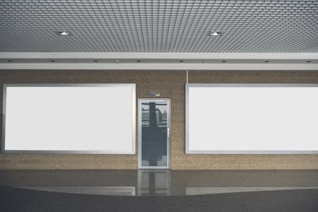 Silver door locating between two big boards for text indoor. Copy space