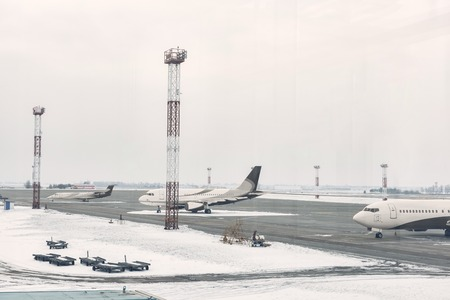 Three huge beautiful airplanes waiting for flight while situating on airdrome Imagens