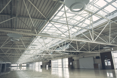 Huge empty storehouse inside with wide windows for renting it