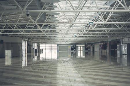 Interior of grey big empty warehouse complex with pendant lamps Banco de Imagens