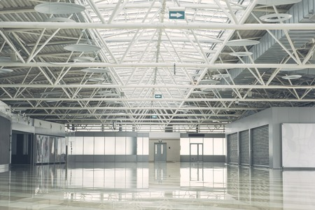 Big empty building inside with wide windows for renting it. Stock Photo