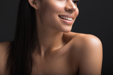 Close up of happy girl with long hair, soft skin and beautiful smile. Isolated on black background Stock Photo