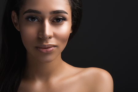 Close up portrait of lady with heathy skin tone looking at camera with calmness. Copy space in right side. Isolated on background Stock Photo