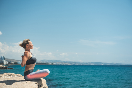 Side view beaming woman making exercise on open air. Copy space. Leisure and hobby concept Stock Photo
