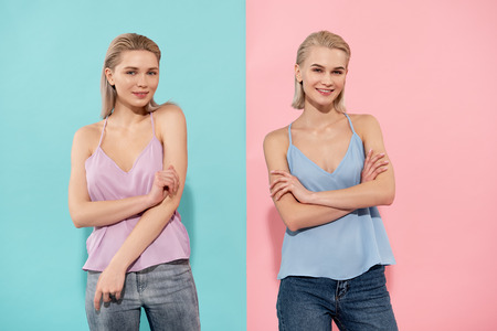 Portrait of two joyful women posing in sleeveless shirts, they are looking at camera with smile Stok Fotoğraf
