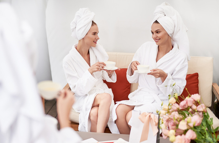 We love this place. Lovely young ladies with towels on heads holding cups with hot drinks and smiling. They wearing soft bathrobes and sitting on couch
