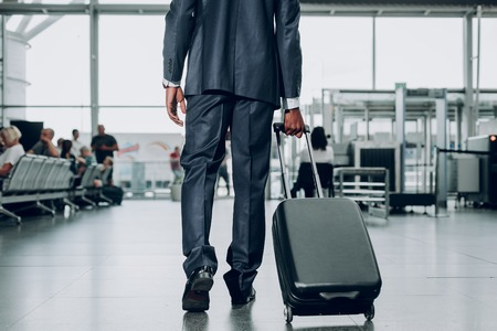 Going to relax. Adult businessman is standing at lounge zone and waiting for arrival of his plane