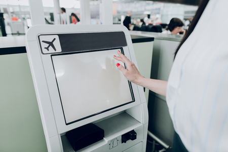 Close up of female hand is pointing on the screen of information terminal inside 版權商用圖片
