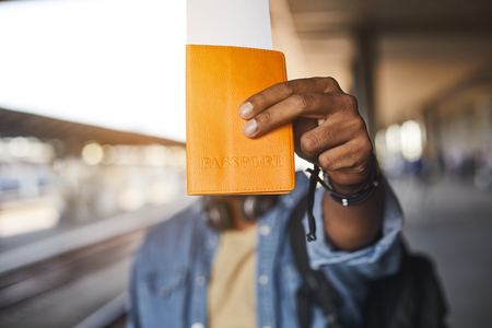 Selective focus of an identification card in hands of a hindu man holding it while standing on the platform Stock Photo