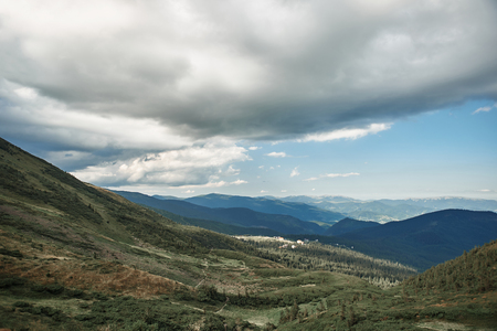 Mountain landscape. Horizontal photo of breathtaking landscape with beautiful mountains and clouds over them