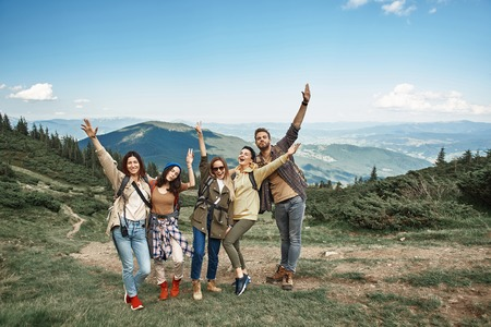 Full length portrait of four women and man standing jointly on ascent to peak. 스톡 콘텐츠 - 110953511