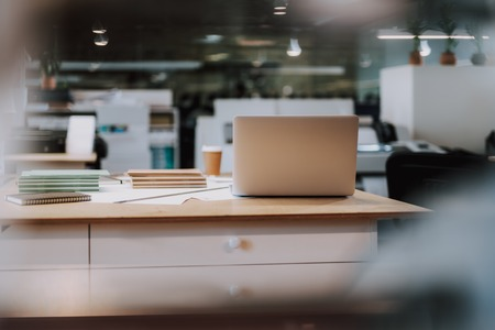 Open white laptop for work is standing on big office table Stock Photo