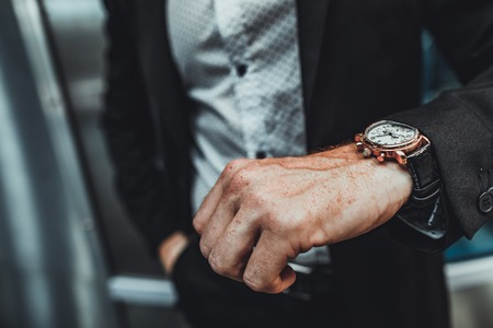 Close up of an expensive wrist watch on the hand of a successful businessman