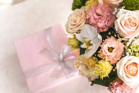 Close up of wonderful bouquet of flowers and little rose giftwrap Stock Photo