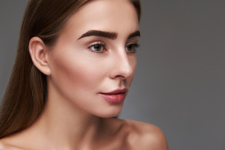 Close up portrait of beautiful woman with perfect skin looking away with serene expression 版權商用圖片