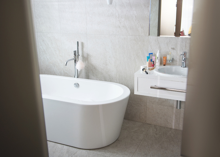 Picture of bathroom with wash sink and white tub