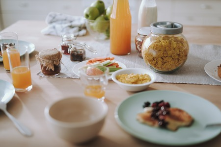 Healthy breakfast on the table with juice in bottle and glasses Reklamní fotografie