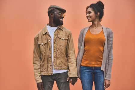 positive young interracial couple looking at each other Stock Photo