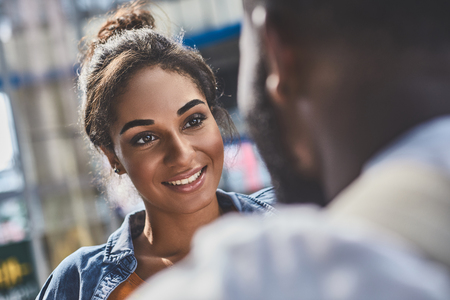 Portrait of an attractive mixed race woman sanding with her boyfriend Stock Photo
