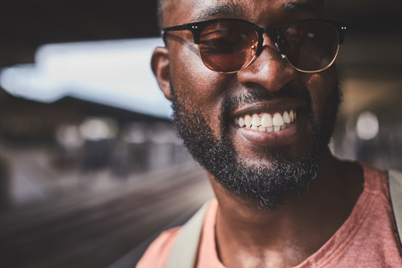Happy man in sunglasses with beautiful smile Stock Photo