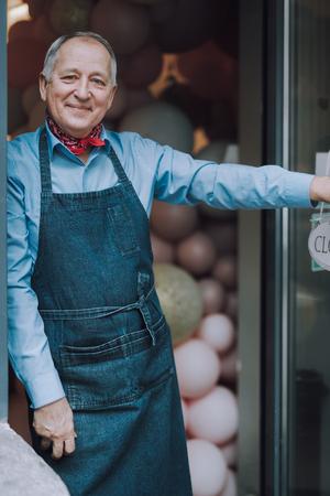 Good-looking old man standing in the doorway of cafe Stok Fotoğraf - 119178897
