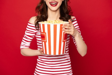 Happyyoung lady with big box of pop corn