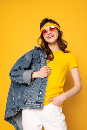 Happy hipster girl posing on camera on yellow Stok Fotoğraf
