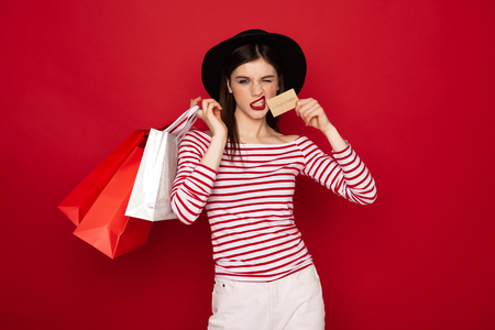 Stylish lady with shopping packs and credit card
