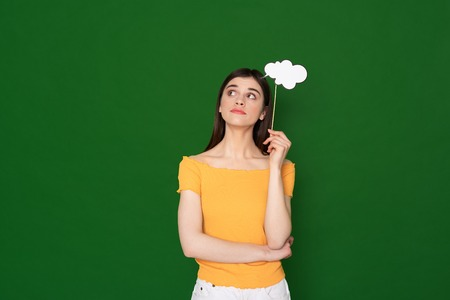 Guessed young girl with paper sample of thoughts