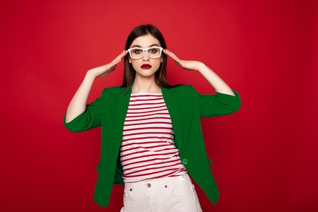 Young stylish lady gracefully holding on glasses 写真素材