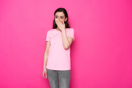 Cropped photo of happy brunette Caucasian girl posing for camera in studio