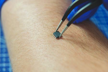 Close up of microcircuit lying on male hand 免版税图像