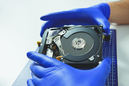 High angle of computer HDD with different details isolated on white background