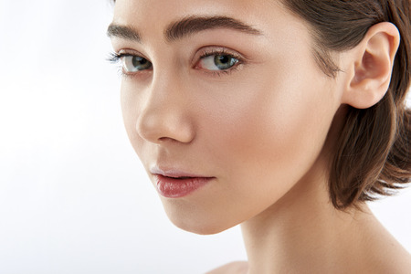 Portrait of pretty green eyed brunette female Stock fotó