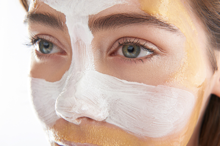Upper face of pretty woman with cosmetic mask