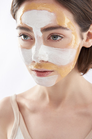 Portrait of young pretty woman with face mask