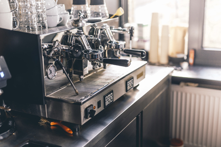 Group espresso machine with clean dishes on it