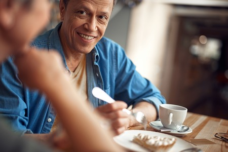 Happy smiling aged man looking to female