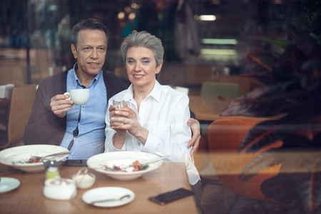 Happy elegant aged couple meeting in cafe Stock Photo