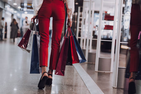 Stylish lady is going on shopping in mall