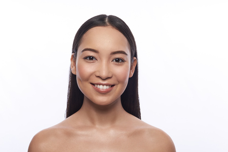 Portrait of cute Asian woman against the white background