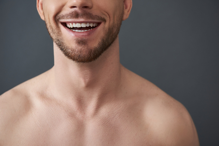 Cropped photo of naked attractive Caucasian guy posing for camera Stock Photo
