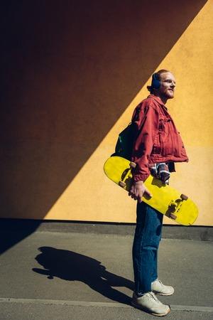 Skater man listen to music via headphones