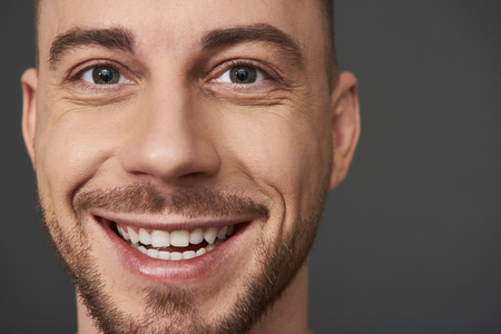 Close up portrait of handsome bearded young man posing in studio