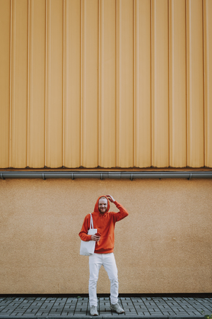 Happy smiling hipster man in red fleece on walk