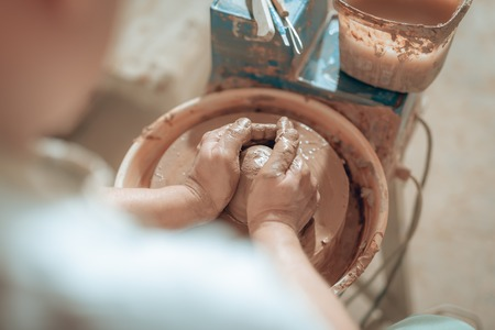 Cropped photo of male hands with clay in potters studio 版權商用圖片