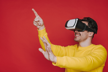Side view of man gesticulating with hands while situating in virtual reality Banco de Imagens